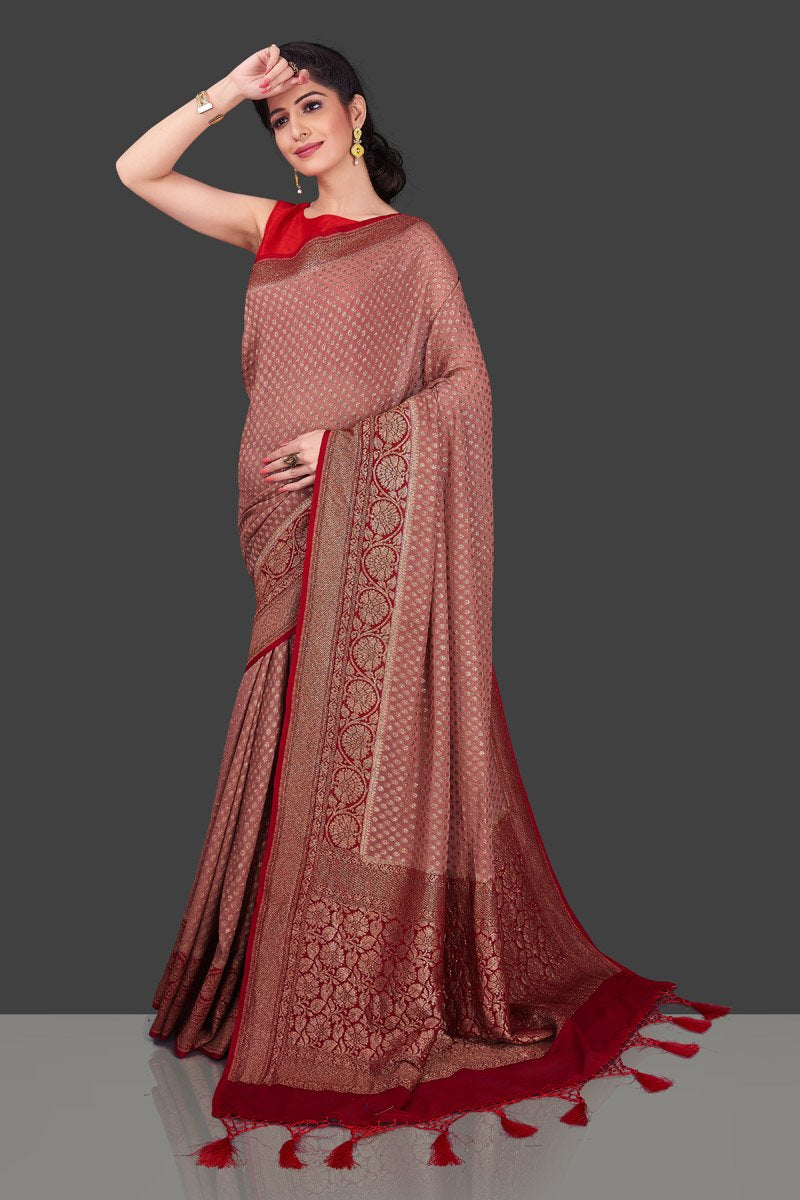Buy charming dusty pink georgette Banarasi saree online in USA with red zari border. Shop beautiful Banarasi sarees, georgette sarees, pure muga silk sarees in USA from Pure Elegance Indian fashion boutique in USA. Get spoiled for choices with a splendid variety of Indian saris to choose from! Shop now.-full view
