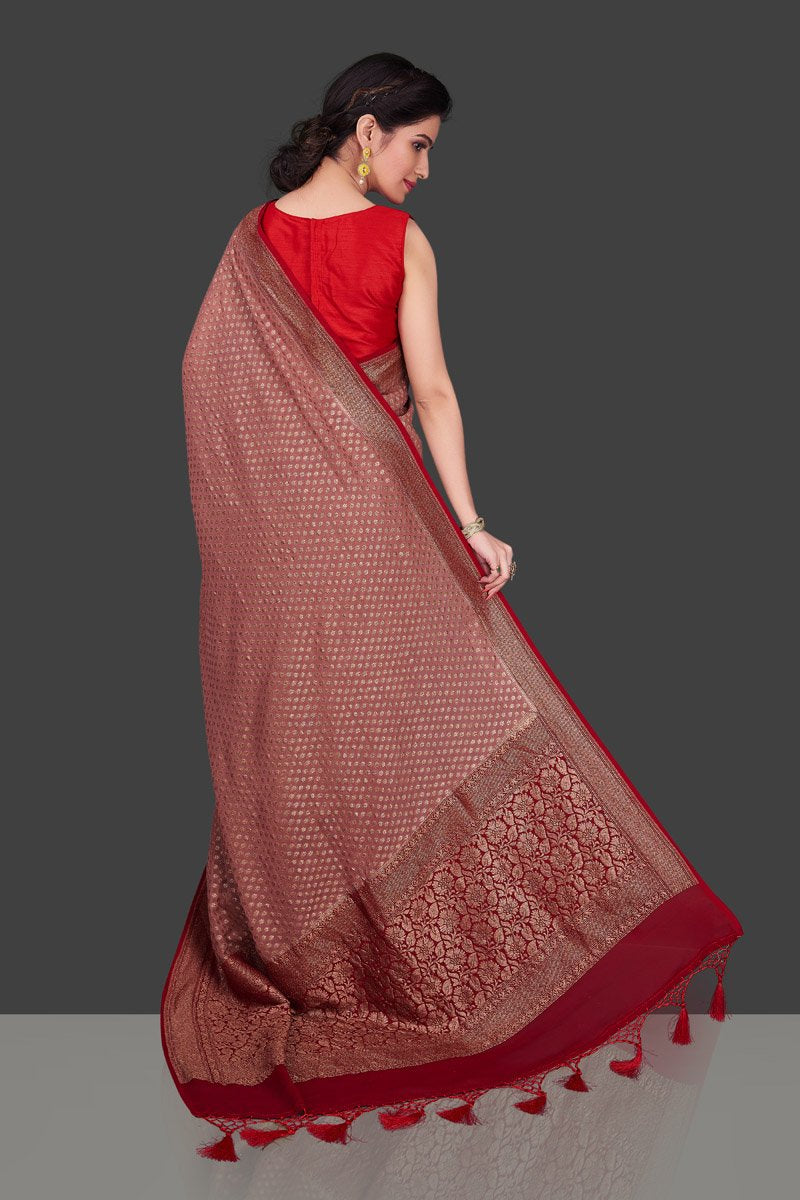 Buy charming dusty pink georgette Banarasi saree online in USA with red zari border. Shop beautiful Banarasi sarees, georgette sarees, pure muga silk sarees in USA from Pure Elegance Indian fashion boutique in USA. Get spoiled for choices with a splendid variety of Indian saris to choose from! Shop now.-back