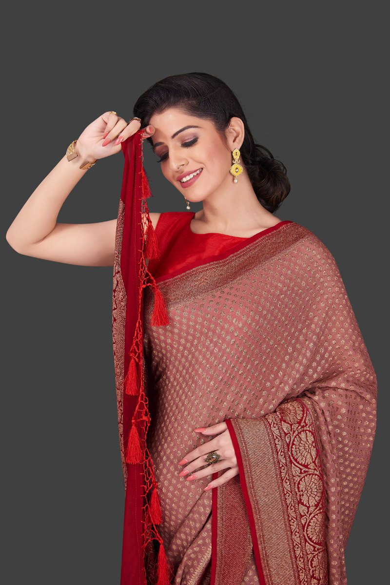 Buy charming dusty pink georgette Banarasi saree online in USA with red zari border. Shop beautiful Banarasi sarees, georgette sarees, pure muga silk sarees in USA from Pure Elegance Indian fashion boutique in USA. Get spoiled for choices with a splendid variety of Indian saris to choose from! Shop now.-closeup