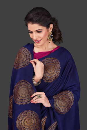 Shop navy borderless muga Banarasi saree online in USA with big antique zari buta. Shop beautiful Banarasi sarees, georgette sarees, pure muga silk sarees in USA from Pure Elegance Indian fashion boutique in USA. Get spoiled for choices with a splendid variety of designer saris to choose from! Shop now.-closeup