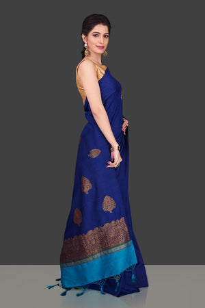 Buy stunning dark blue borderless muga Banarasi sari online in USA with floral zari buta. Shop beautiful Banarasi sarees, georgette sarees, pure muga silk sarees in USA from Pure Elegance Indian fashion boutique in USA. Get spoiled for choices with a splendid variety of designer saris to choose from! Shop now.-side