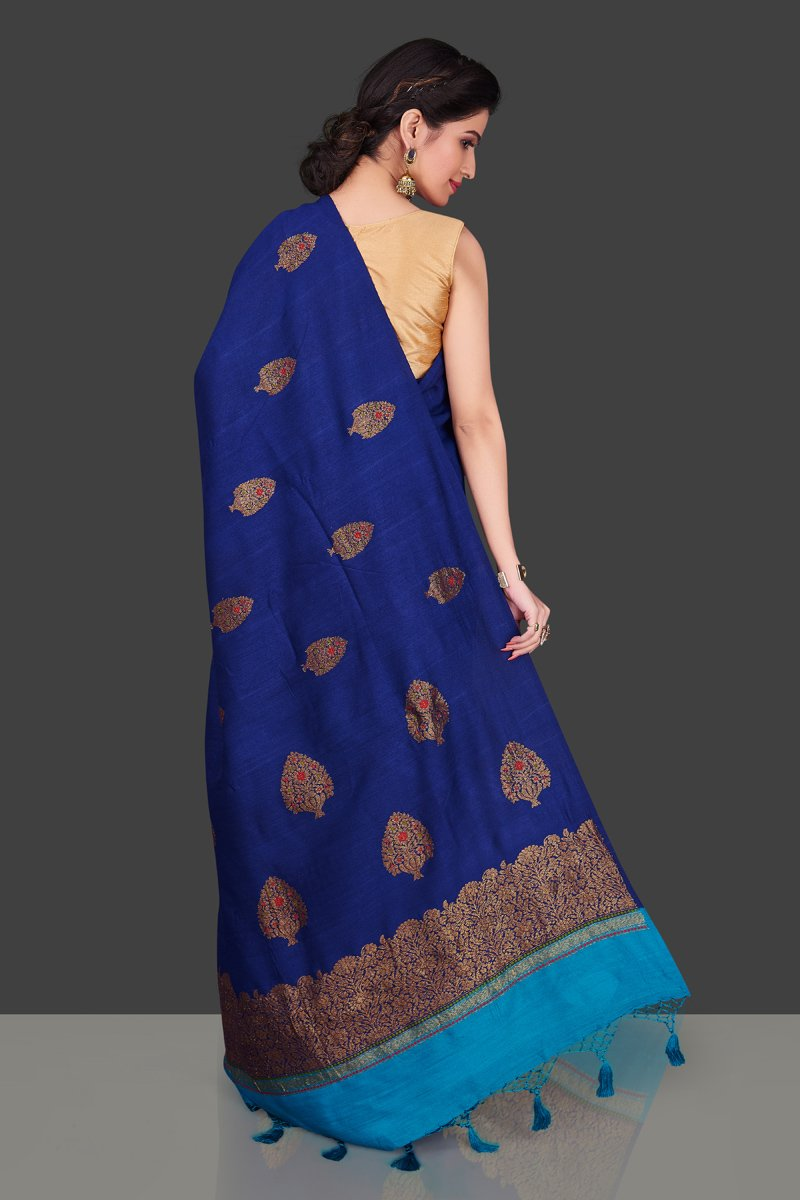 Buy stunning dark blue borderless muga Banarasi sari online in USA with floral zari buta. Shop beautiful Banarasi sarees, georgette sarees, pure muga silk sarees in USA from Pure Elegance Indian fashion boutique in USA. Get spoiled for choices with a splendid variety of designer saris to choose from! Shop now.-back