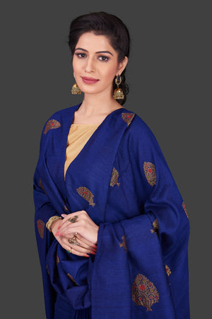 Buy stunning dark blue borderless muga Banarasi sari online in USA with floral zari buta. Shop beautiful Banarasi sarees, georgette sarees, pure muga silk sarees in USA from Pure Elegance Indian fashion boutique in USA. Get spoiled for choices with a splendid variety of designer saris to choose from! Shop now.-closeup