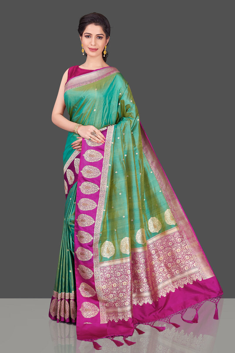 Shop green Banarasi silk sari in USA with magenta zari border. Shop beautiful Banarasi silk sarees, tussar saris, pure muga silk saris in USA from Pure Elegance Indian fashion boutique in USA. Get spoiled for choices with a splendid variety of Indian sarees to choose from! Shop now.-full view