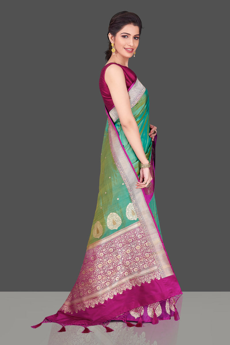 Shop green Banarasi silk sari in USA with magenta zari border. Shop beautiful Banarasi silk sarees, tussar saris, pure muga silk saris in USA from Pure Elegance Indian fashion boutique in USA. Get spoiled for choices with a splendid variety of Indian sarees to choose from! Shop now.-side
