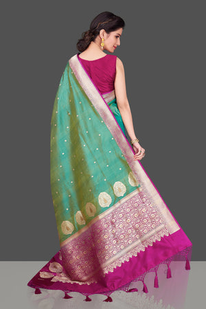 Shop green Banarasi silk sari in USA with magenta zari border. Shop beautiful Banarasi silk sarees, tussar saris, pure muga silk saris in USA from Pure Elegance Indian fashion boutique in USA. Get spoiled for choices with a splendid variety of Indian sarees to choose from! Shop now.-back