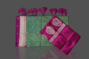 Shop green Banarasi silk sari in USA with magenta zari border. Shop beautiful Banarasi silk sarees, tussar saris, pure muga silk saris in USA from Pure Elegance Indian fashion boutique in USA. Get spoiled for choices with a splendid variety of Indian sarees to choose from! Shop now.-details