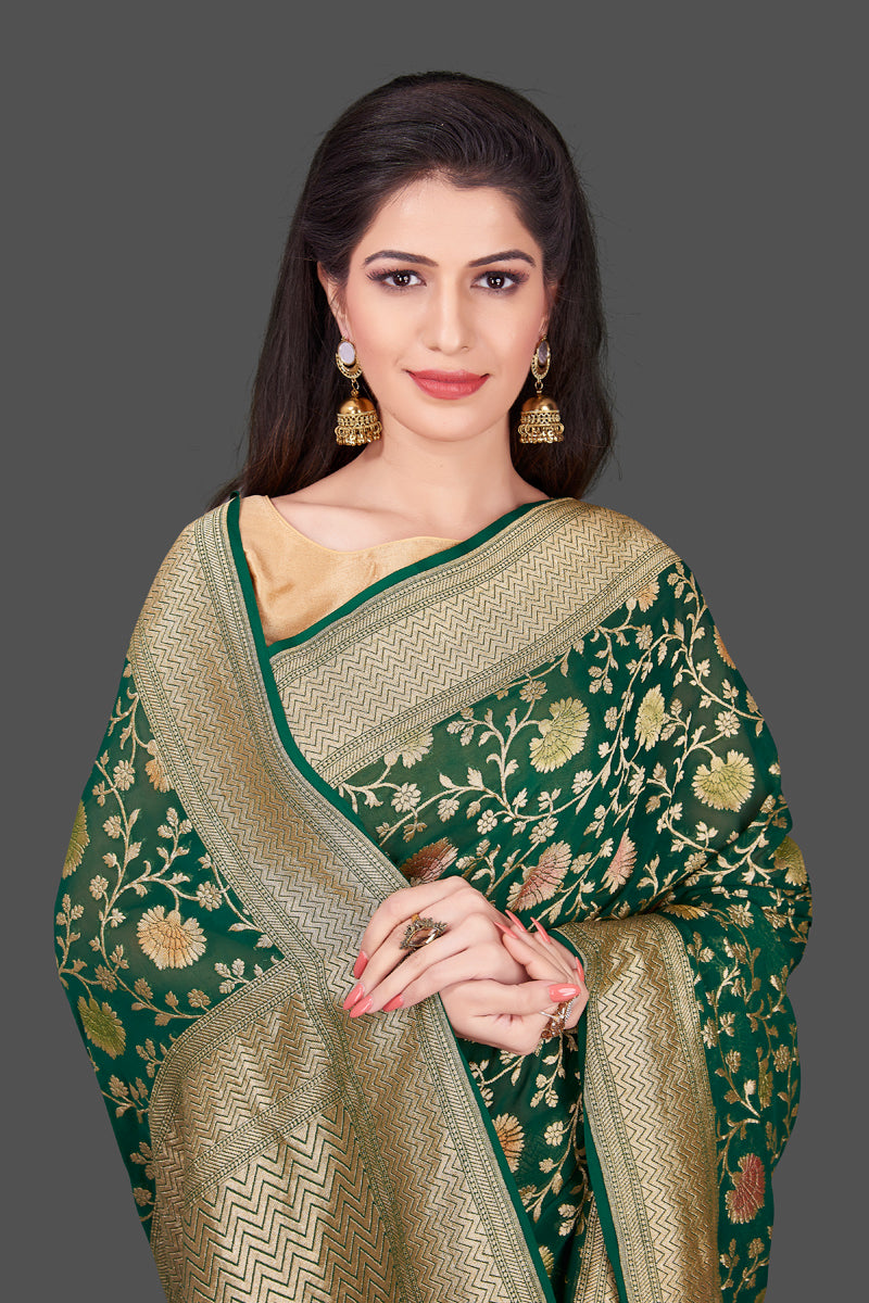 Buy dark green Benarasi georgette sari online in USA with floral zari jaal. Shop beautiful Banarasi georgette sarees, tussar sarees, pure muga silk saris in USA from Pure Elegance Indian fashion boutique in USA. Get spoiled for choices with a splendid variety of Indian sarees to choose from! Shop now.-closeup
