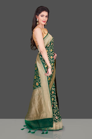 Buy dark green Benarasi georgette sari online in USA with floral zari jaal. Shop beautiful Banarasi georgette sarees, tussar sarees, pure muga silk saris in USA from Pure Elegance Indian fashion boutique in USA. Get spoiled for choices with a splendid variety of Indian sarees to choose from! Shop now.-side