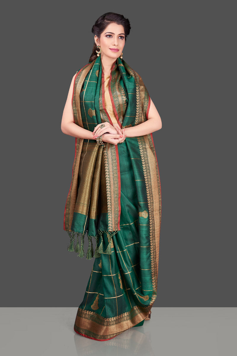 Shop beautiful dark green zari check tassar Banarasi sari in USA with antique zari border. Shop beautiful Banarasi georgette sarees, tussar saris, pure muga silk saris in USA from Pure Elegance Indian fashion boutique in USA. Get spoiled for choices with a splendid variety of Indian sarees to choose from! Shop now.-full view