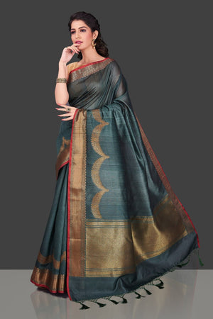 Buy stunning grey tassar Banarasi sari in USA with antique zari border. Shop beautiful Banarasi georgette sarees, tussar saris, pure muga silk saris in USA from Pure Elegance Indian fashion boutique in USA. Get spoiled for choices with a splendid variety of Indian sarees to choose from! Shop now.-side