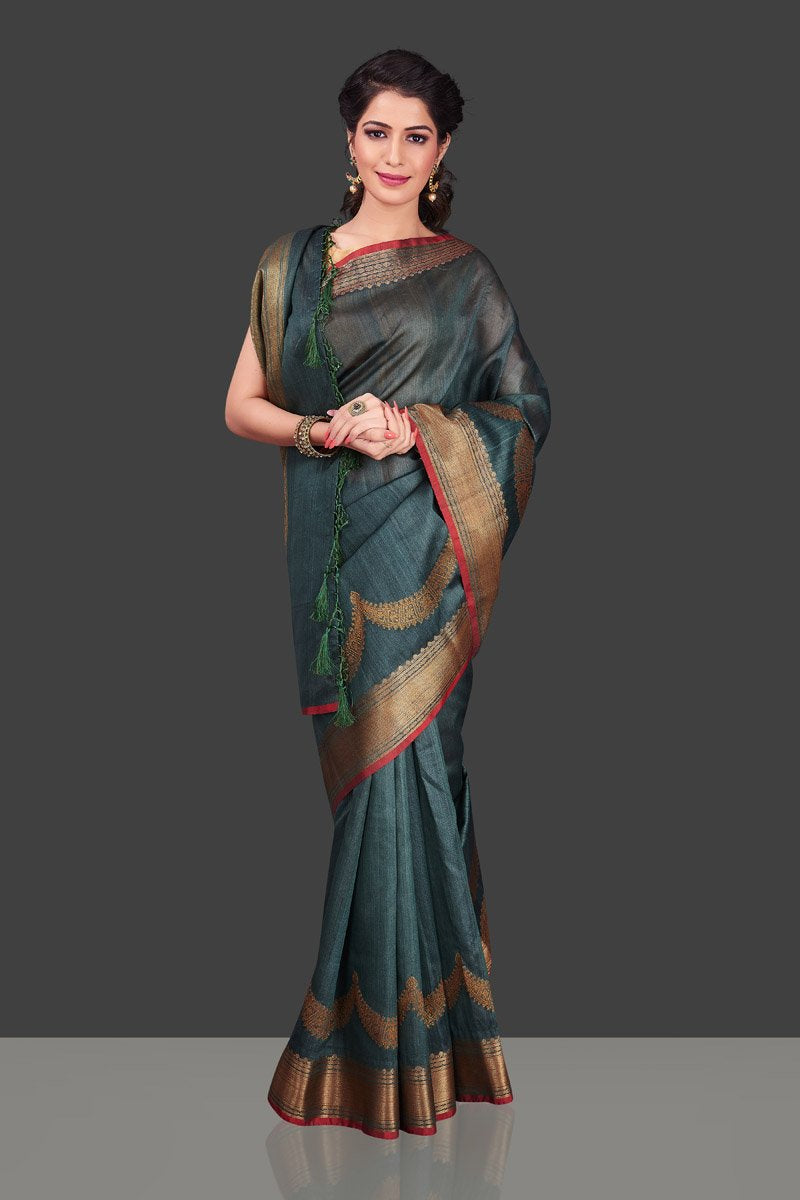 Buy stunning grey tassar Banarasi sari in USA with antique zari border. Shop beautiful Banarasi georgette sarees, tussar saris, pure muga silk saris in USA from Pure Elegance Indian fashion boutique in USA. Get spoiled for choices with a splendid variety of Indian sarees to choose from! Shop now.-front