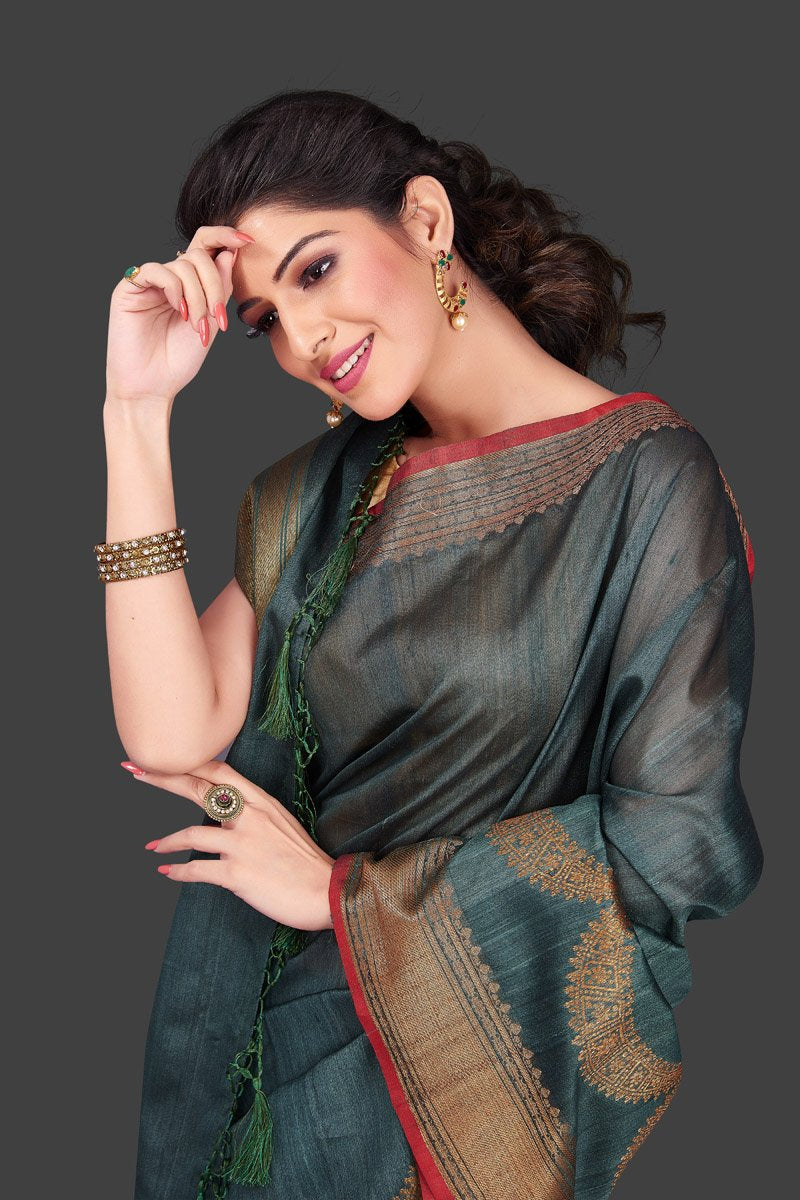 Buy stunning grey tassar Banarasi sari in USA with antique zari border. Shop beautiful Banarasi georgette sarees, tussar saris, pure muga silk saris in USA from Pure Elegance Indian fashion boutique in USA. Get spoiled for choices with a splendid variety of Indian sarees to choose from! Shop now.-closeup
