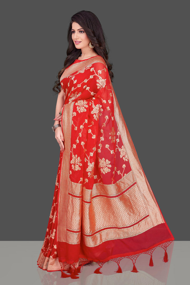 Buy bright red Banarasi georgette saree online in USA with floral zari work. Shop beautiful Banarasi georgette sarees, tussar saris, pure muga silk saris in USA from Pure Elegance Indian fashion boutique in USA. Get spoiled for choices with a splendid variety of Indian sarees to choose from! Shop now.-side