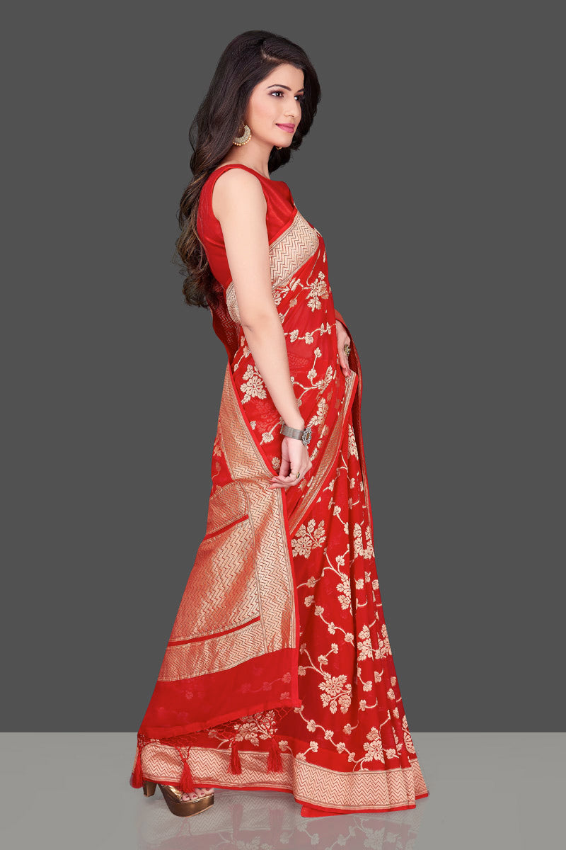 Buy bright red Banarasi georgette saree online in USA with floral zari work. Shop beautiful Banarasi georgette sarees, tussar saris, pure muga silk saris in USA from Pure Elegance Indian fashion boutique in USA. Get spoiled for choices with a splendid variety of Indian sarees to choose from! Shop now.-rightside