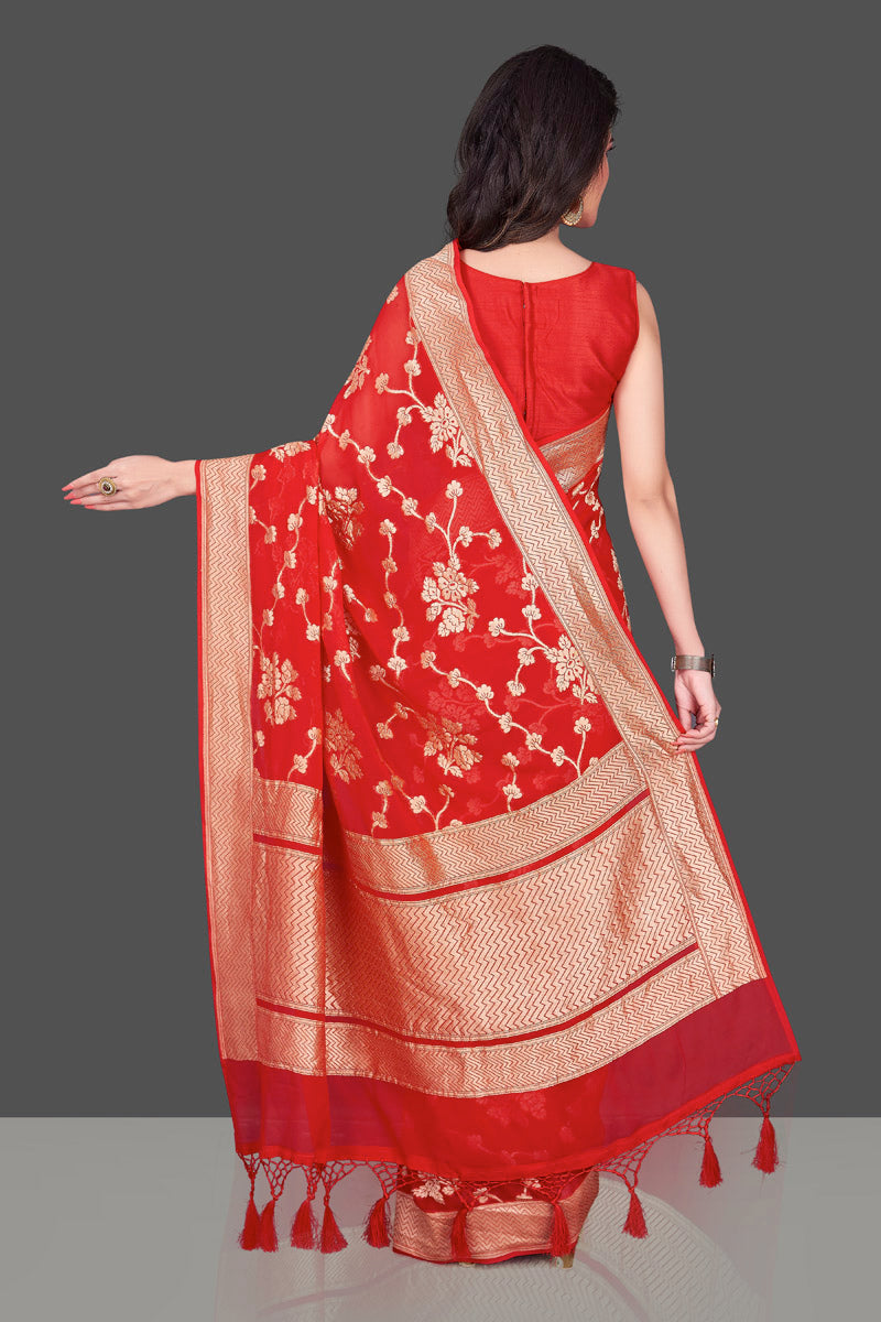 Buy bright red Banarasi georgette saree online in USA with floral zari work. Shop beautiful Banarasi georgette sarees, tussar saris, pure muga silk saris in USA from Pure Elegance Indian fashion boutique in USA. Get spoiled for choices with a splendid variety of Indian sarees to choose from! Shop now.-back