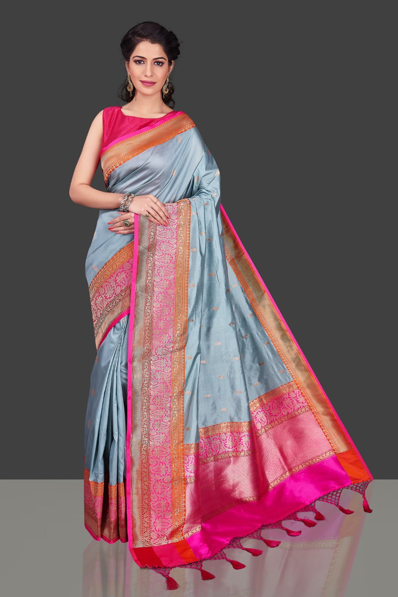 Buy light grey Banarasi silk saree online in USA with pink orange zari border. Shop beautiful Banarasi georgette sarees, tussar saris, pure muga silk saris in USA from Pure Elegance Indian fashion boutique in USA. Get spoiled for choices with a splendid variety of Indian sarees to choose from! Shop now.-full view