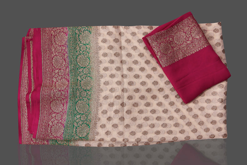 Buy online lovely off-white georgette Benarasi saree in USA with pink green zari border. Shop beautiful Banarasi georgette sarees, tussar saris, pure muga silk saris in USA from Pure Elegance Indian fashion boutique in USA. Get spoiled for choices with a splendid variety of Indian sarees to choose from! Shop now.-details