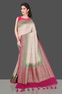Buy online lovely off-white georgette Benarasi saree in USA with pink green zari border. Shop beautiful Banarasi georgette sarees, tussar saris, pure muga silk saris in USA from Pure Elegance Indian fashion boutique in USA. Get spoiled for choices with a splendid variety of Indian sarees to choose from! Shop now.-full view