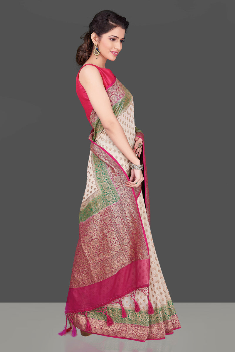 Buy online lovely off-white georgette Benarasi saree in USA with pink green zari border. Shop beautiful Banarasi georgette sarees, tussar saris, pure muga silk saris in USA from Pure Elegance Indian fashion boutique in USA. Get spoiled for choices with a splendid variety of Indian sarees to choose from! Shop now.-side