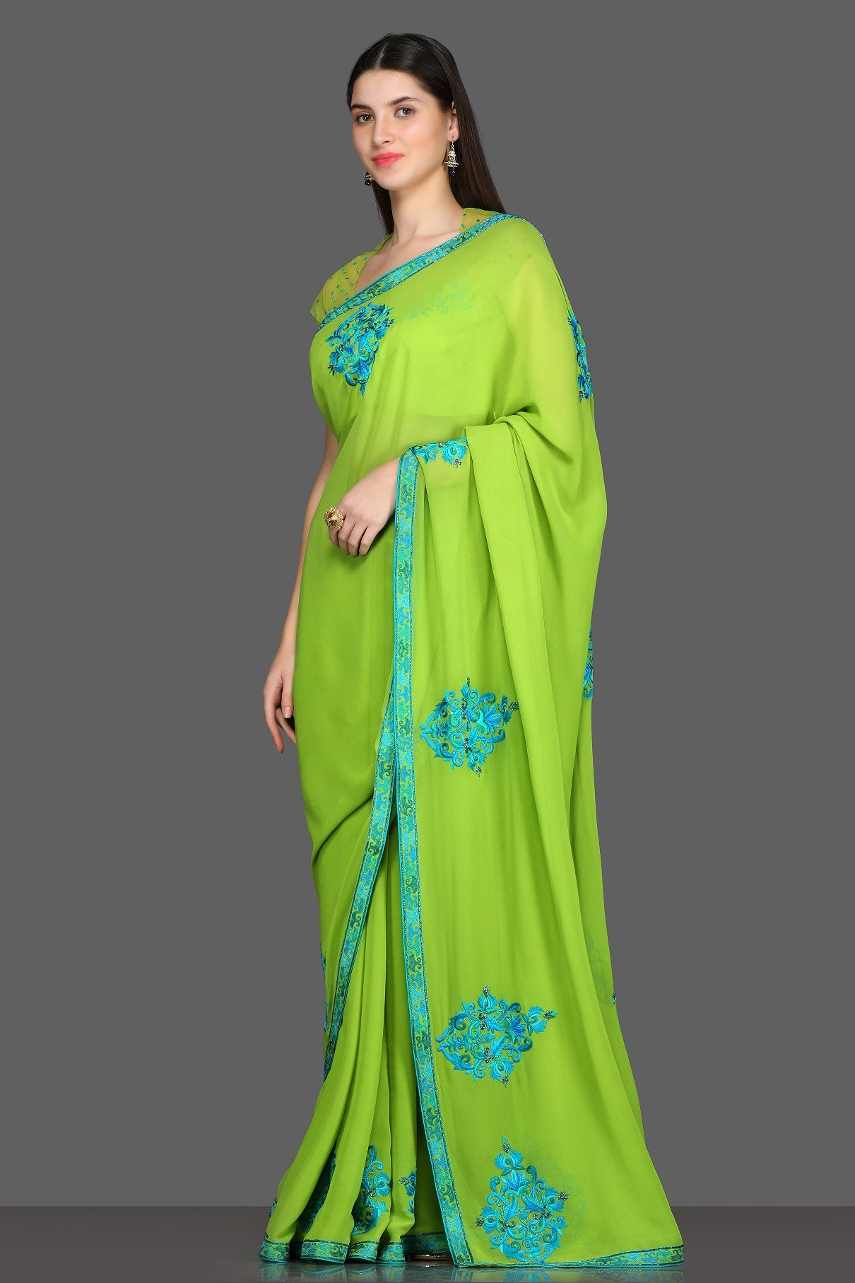 Buy green embroidered saree online in USA with matching saree blouse. Make a fashion statement at parties with stunning designer sarees from Pure Elegance Indian fashion store in USA.-side