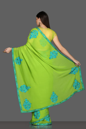 Buy green embroidered saree online in USA with matching saree blouse. Make a fashion statement at parties with stunning designer sarees from Pure Elegance Indian fashion store in USA.-back