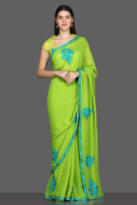 Buy green embroidered saree online in USA with matching saree blouse. Make a fashion statement at parties with stunning designer sarees from Pure Elegance Indian fashion store in USA.-full view
