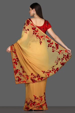 Buy yellow embroidered saree online in USA with red embroidered saree blouse. Make a fashion statement at parties with stunning designer sarees from Pure Elegance Indian fashion store in USA.-back