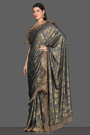 Buy stunning grey ruffle saree online in USA with golden design and bell sleeves embroidered saree blouse. Make a fashion statement at parties with stunning designer sarees from Pure Elegance Indian fashion store in USA.-side