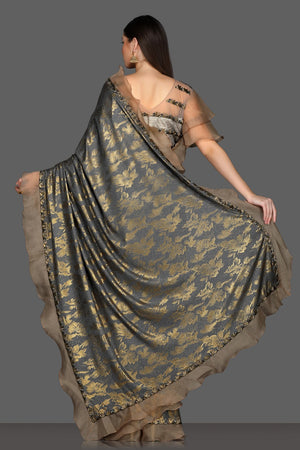 Buy stunning grey ruffle saree online in USA with golden design and bell sleeves embroidered saree blouse. Make a fashion statement at parties with stunning designer sarees from Pure Elegance Indian fashion store in USA.-back