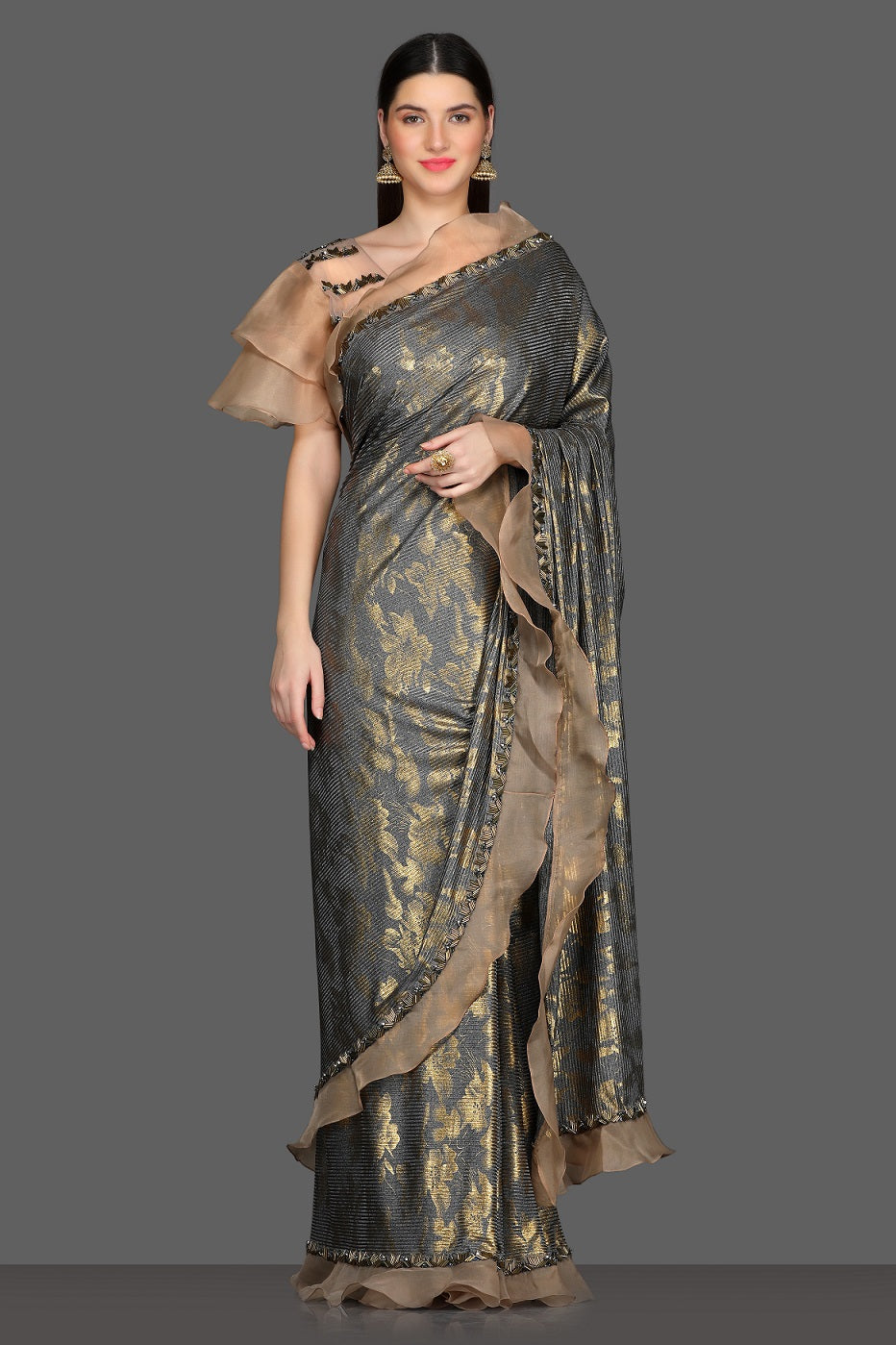 Buy stunning grey ruffle saree online in USA with golden design and bell sleeves embroidered saree blouse. Make a fashion statement at parties with stunning designer sarees from Pure Elegance Indian fashion store in USA.-full view