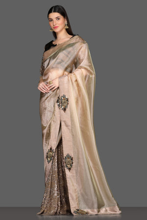 Buy golden embroidered designer saree online in USA with brown embroidered sari blouse. Make a fashion statement at parties with stunning designer sarees from Pure Elegance Indian fashion store in USA.-side