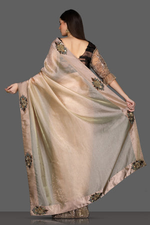 Buy golden embroidered designer saree online in USA with brown embroidered sari blouse. Make a fashion statement at parties with stunning designer sarees from Pure Elegance Indian fashion store in USA.-back