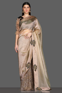 Buy golden embroidered designer saree online in USA with brown embroidered sari blouse. Make a fashion statement at parties with stunning designer sarees from Pure Elegance Indian fashion store in USA.-full view