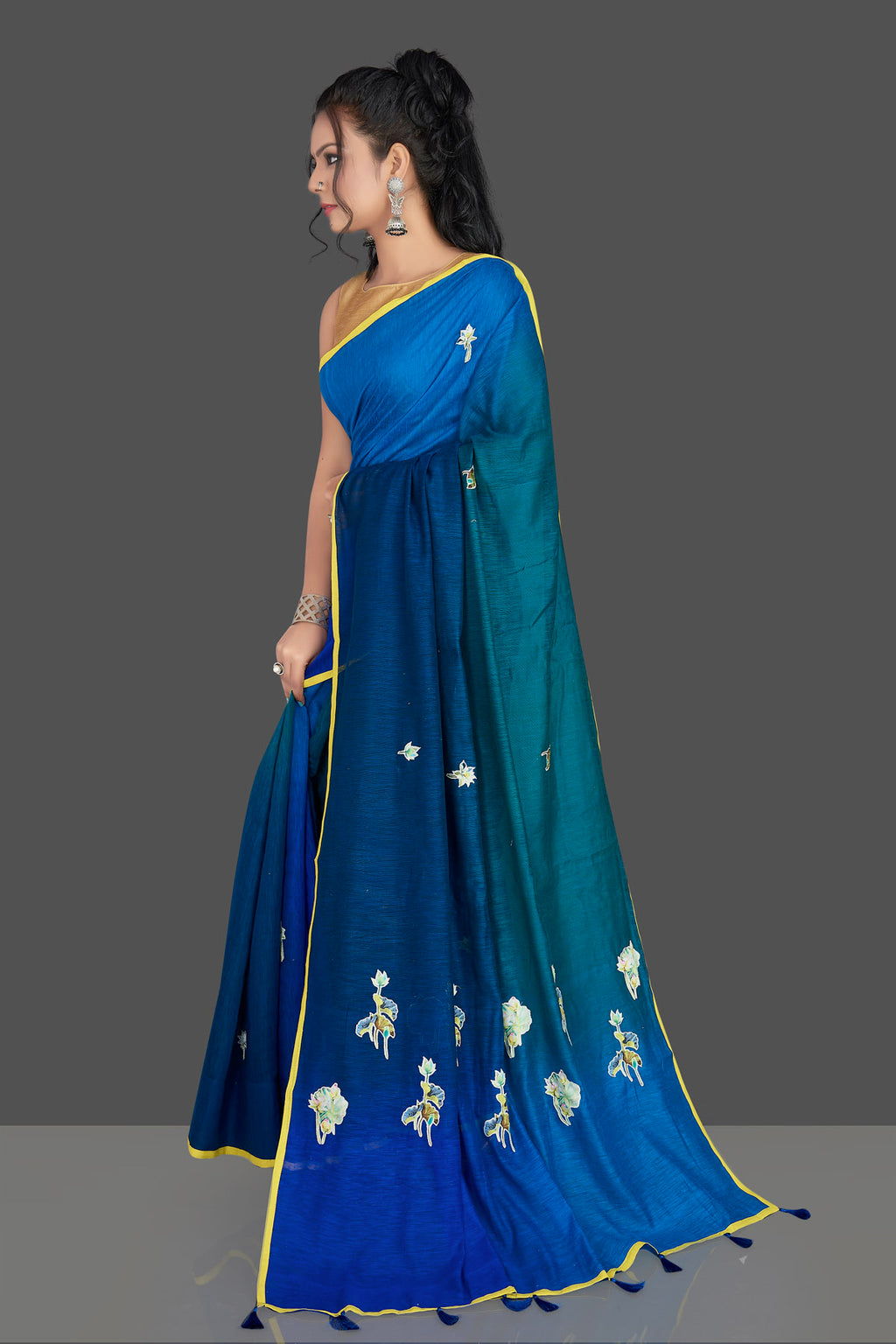 Shop blue and green applique work linen saree online in USA with white floral saree blouse. Radiate elegance with designer sarees with blouse, linen sarees from Pure Elegance Indian fashion boutique in USA. We bring a especially curated collection of ethnic saris for Indian women in USA under one roof!-full view