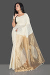 Shop elegant off-white applique linen sari online in USA with tissue pallu and saree blouse. Radiate elegance with designer sarees with blouse, linen sarees from Pure Elegance Indian fashion boutique in USA. We bring a especially curated collection of ethnic saris for Indian women in USA under one roof!-full view
