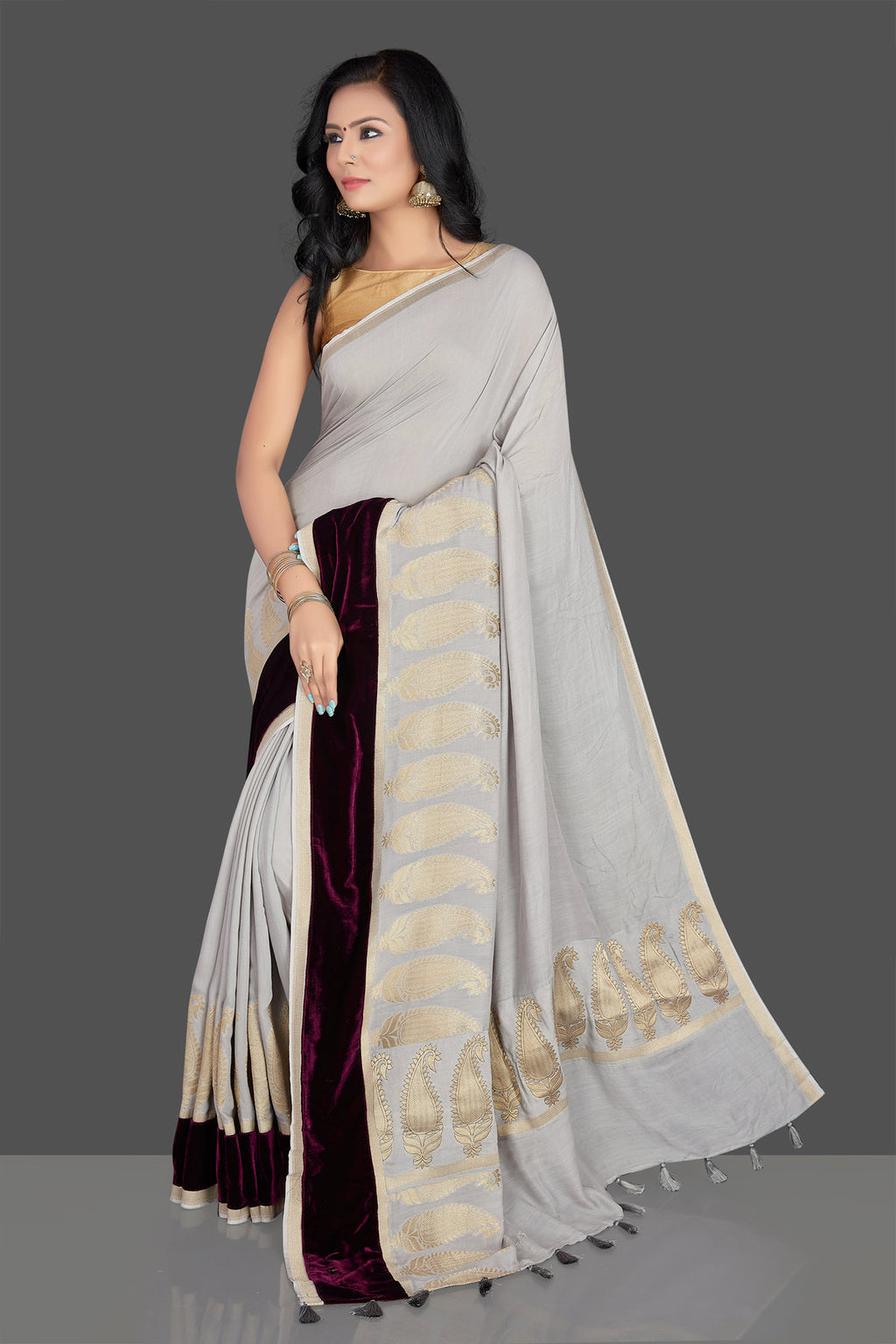 Shop elegant light grey muga Banarsi saree online in USA with velvet border and velvet blouse. Radiate elegance with designer sarees with blouse, Banarasi muga sarees from Pure Elegance Indian fashion boutique in USA. We bring a especially curated collection of ethnic sarees for Indian women in USA under one roof!-full view