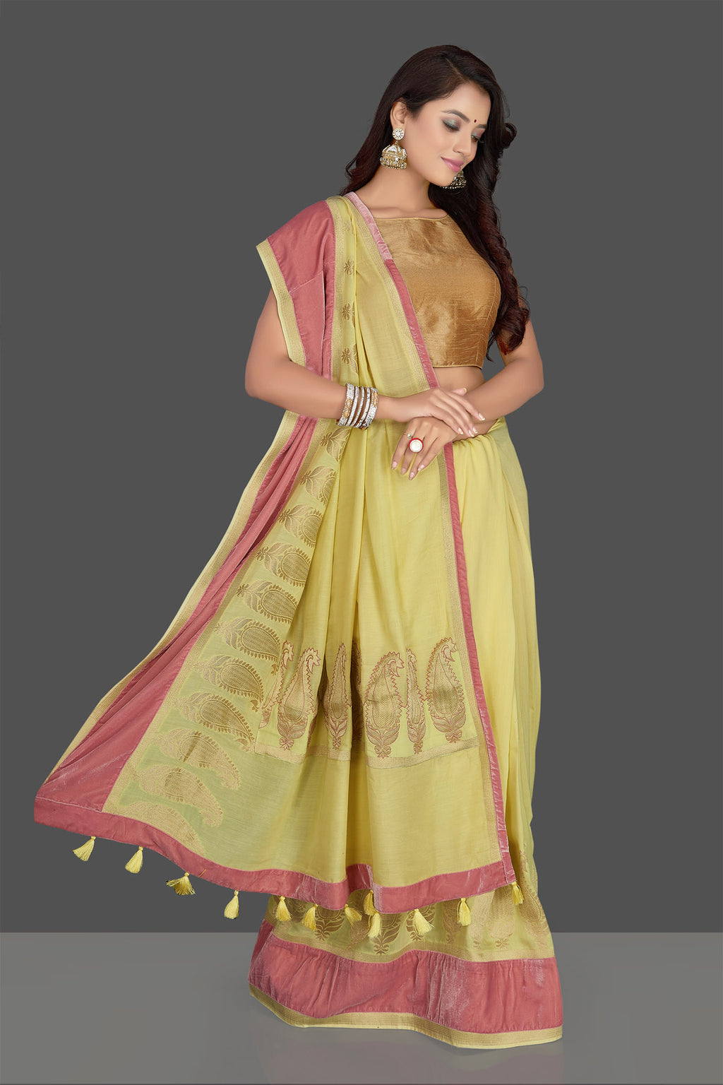 Buy charming yellow muga Banarsi sari online in USA with pink velvet border and velvet blouse. Radiate elegance with designer sarees with blouse, Banarasi muga sarees from Pure Elegance Indian fashion boutique in USA. We bring a especially curated collection of ethnic sarees for Indian women in USA under one roof!-full view