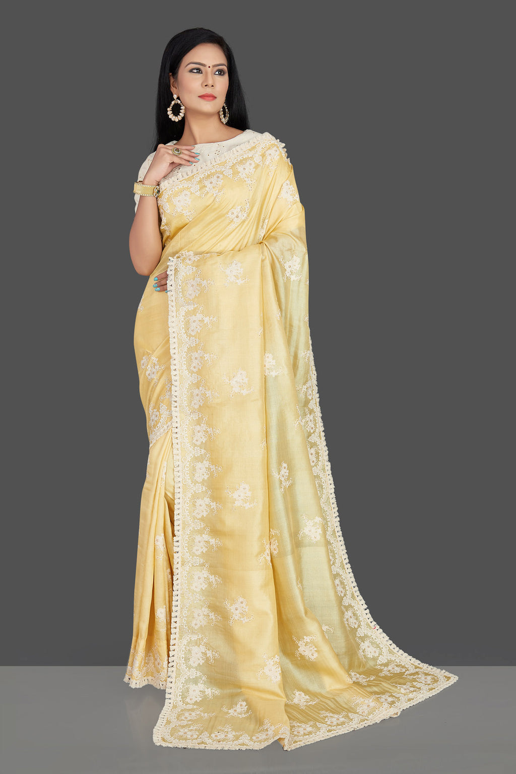 Buy gorgeous lemon yellow embroidered tassar silk sari online in USA with cream embroidered blouse. Make your ethnic wardrobe rich with timeless handwoven sarees, tissue sarees, silk sarees, tussar saris from Pure Elegance Indian clothing store in USA. Find all the designer sarees for special occasions under one roof!-full view