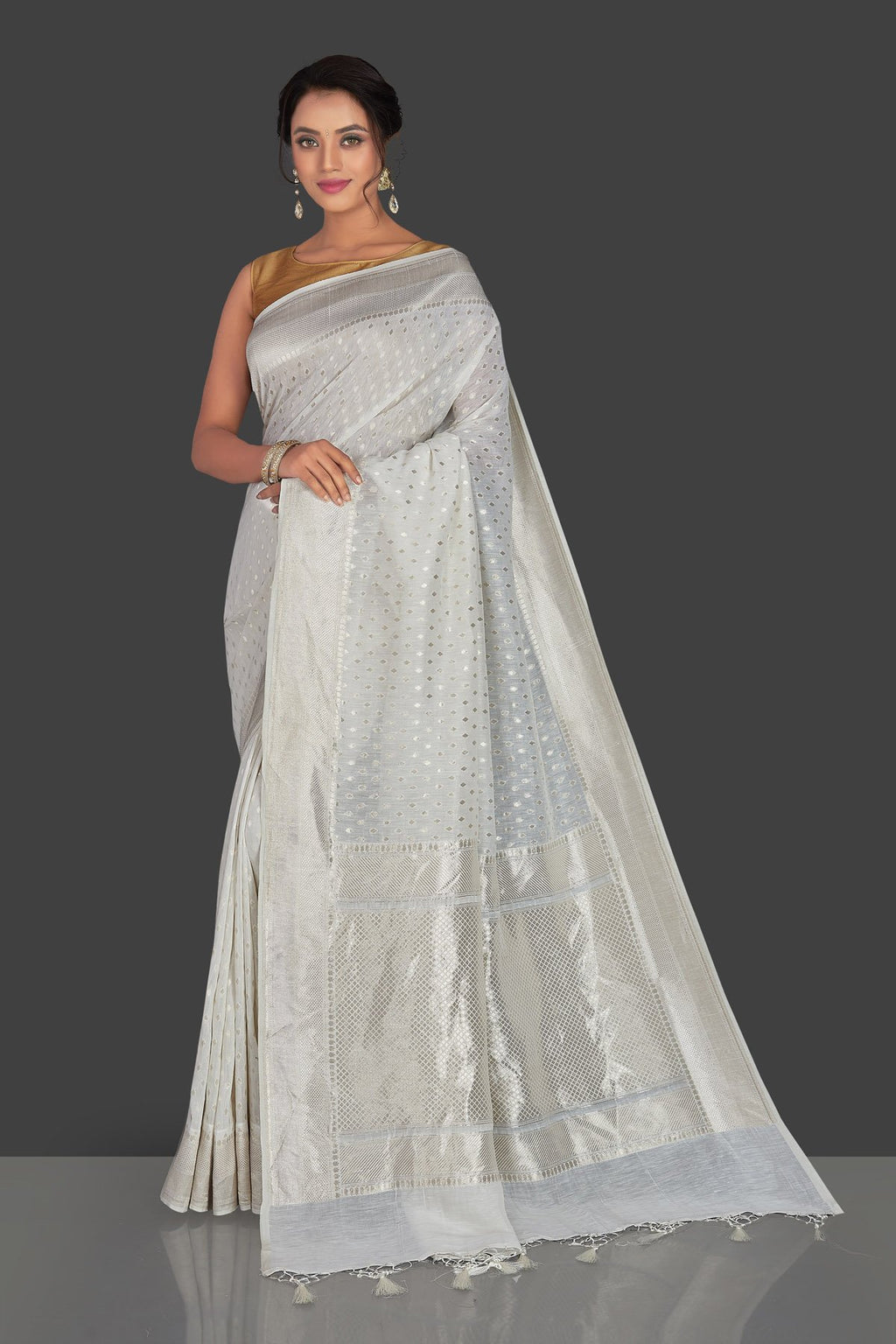 Buy white tussar georgette Banarasi saree online in USA with silver zari border. Radiate elegance with handloom sarees with blouse, tussar silk sarees, Banarsi sarees from Pure Elegance Indian fashion boutique in USA. We bring a especially curated collection of ethnic saris for Indian women in USA under one roof!-full view