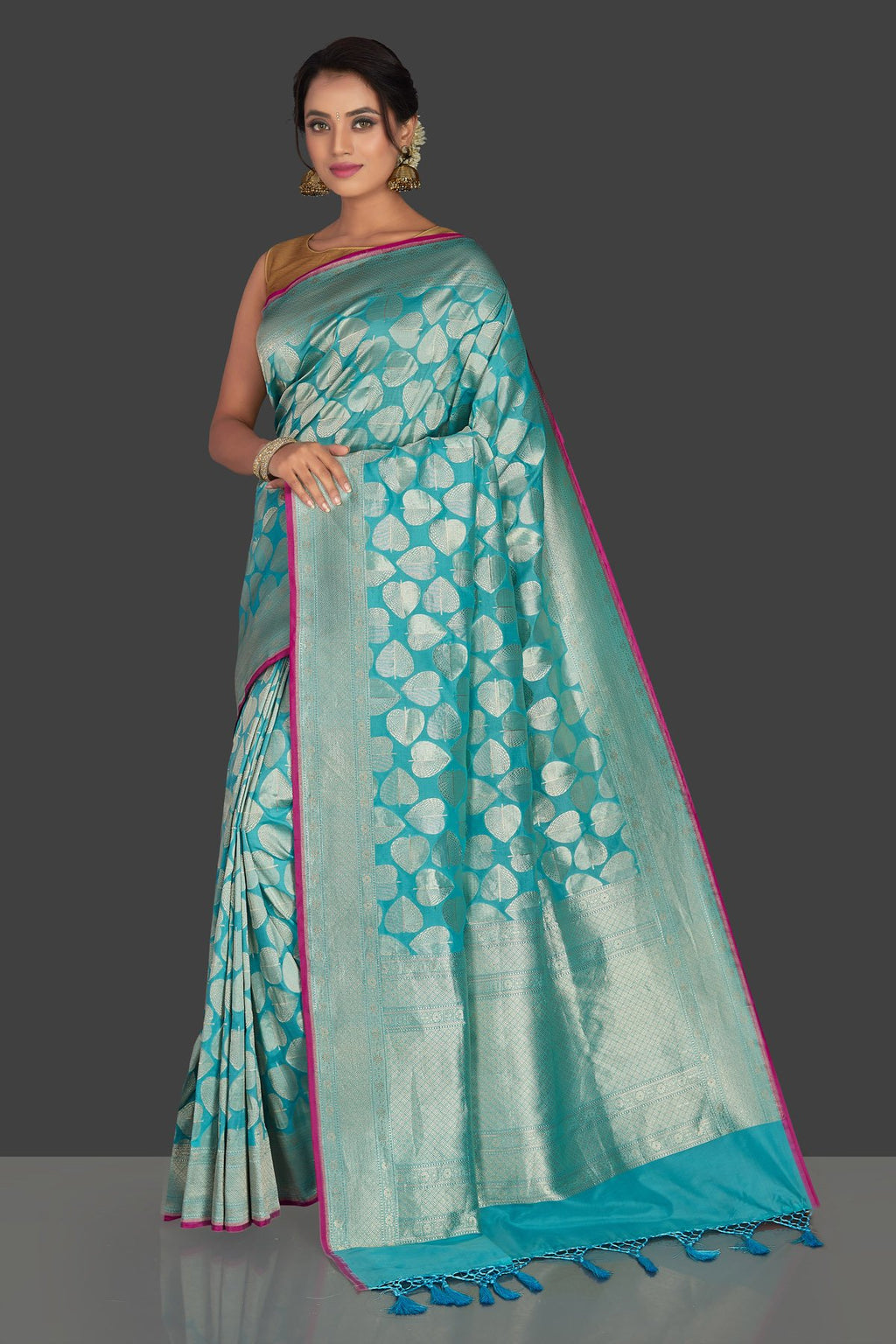Buy turquoise blue tussar georgette saree online in USA with silver zari work. Keep it elegant with georgette sarees, Banarasi silk sarees, handwoven sarees from Pure Elegance Indian fashion boutique in USA. We bring a especially curated collection of ethnic sarees for Indian women in USA under one roof!-full view