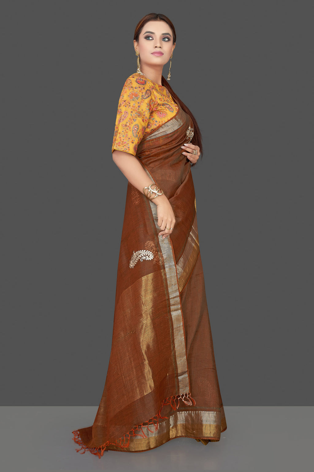 Shop gorgeous brown embroidered linen Banarasi saree online in USA with yellow floral blouse. Shop gorgeous handwoven saris, linen sarees, pure silk sarees, traditional Banarasi sarees in USA from Pure Elegance Indian saree store.-front