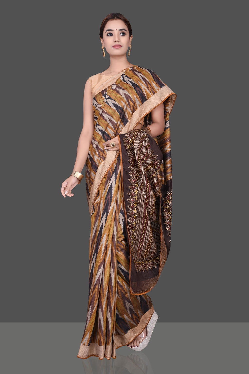 Buy beautiful brown and mustard tussar silk saree online in USA with Kantha work pallu. Shop beautiful silk sarees, hand embroidered saris, georgette sarees, designer sarees in USA from Pure Elegance Indian fashion store in USA. Shop online now.-full view