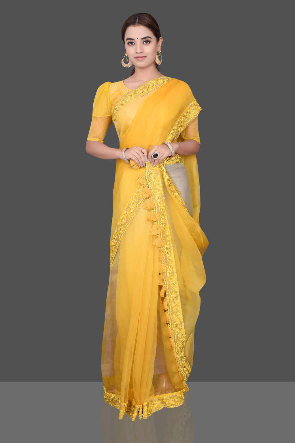 Shop stunning yellow embroidered organza saree online in USA with matching puff sleeves saree blouse. Shop beautiful silk sarees, hand embroidered saris, georgette sarees, designer sarees in USA from Pure Elegance Indian fashion store in USA. Shop online now.-full view