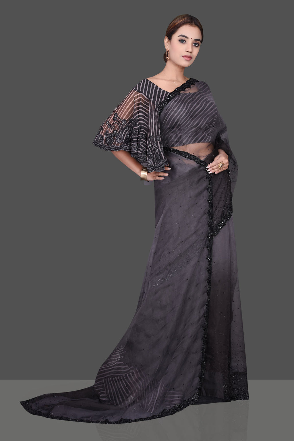 Buy ravishing grey and black crystal work organza  sari online in USA with embroidered  designer saree blouse. Shop beautiful Banarasi sarees, hand embroidered saris, georgette sarees, designer sarees in USA from Pure Elegance Indian fashion store in USA. Shop online now.-full view