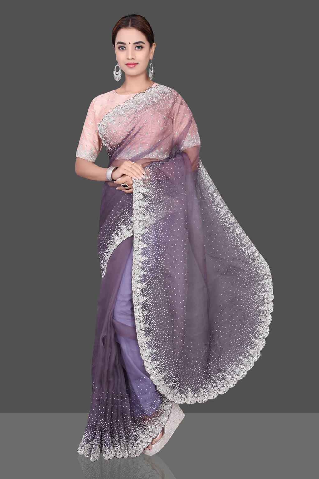 Shop beautiful purple embrpidered organza sari online in USA with embroidered  peach saree blouse. Shop beautiful organza sarees, hand embroidered saris, georgette sarees, designer sarees in USA from Pure Elegance Indian fashion store in USA. Shop online now.-full view