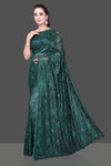 Shop beautiful dark green designer lace sari online in USA with stone work. Be the talk of the parties and special occasions with stunning embroidered sarees, designer saris, pure silk sarees, fancy sarees from Pure Elegance Indian fashion store in USA.-full view