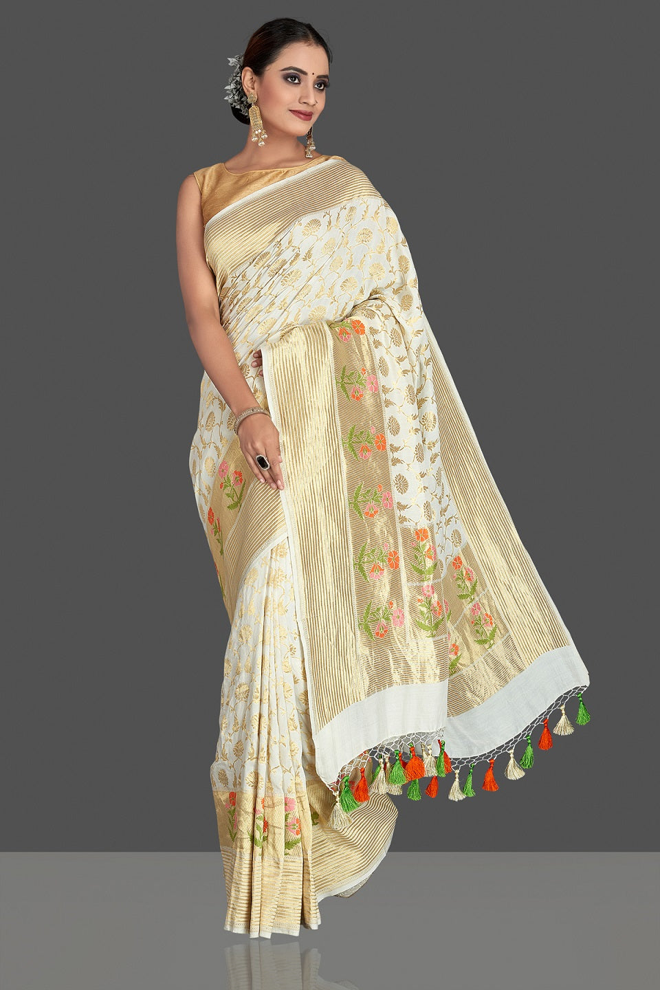 Buy beautiful off-white georgette Banarasi saree online in USA with zari minakari buta on golden zari border. Elevate your traditional style with beautiful Banarasi sarees, designer sarees, pure silk sarees, handwoven saris from Pure Elegance Indian saree store in USA.-full view