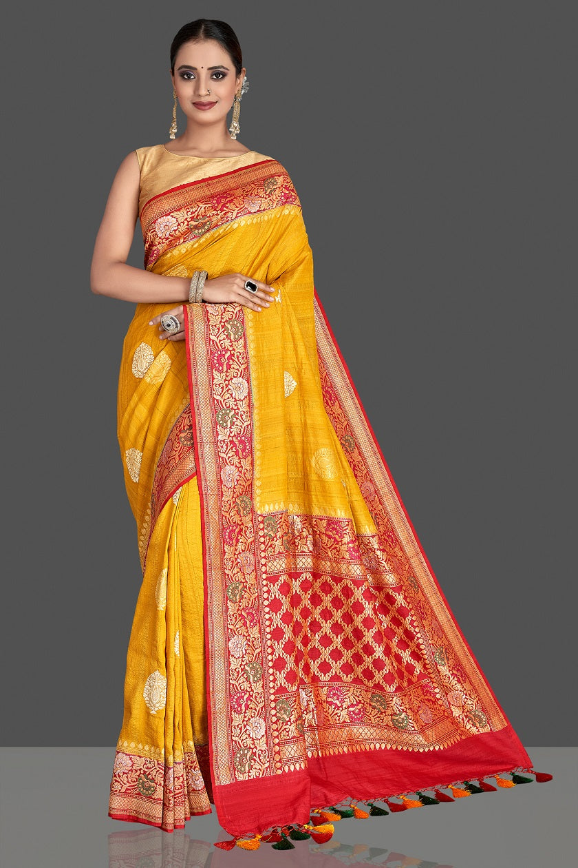 Buy stunning yellow tussar georgette Banarasi saree online in USA with red zari minakari border. Elevate your traditional style with beautiful Banarasi sarees, designer sarees, pure silk sarees, handwoven saris from Pure Elegance Indian saree store in USA.-full view
