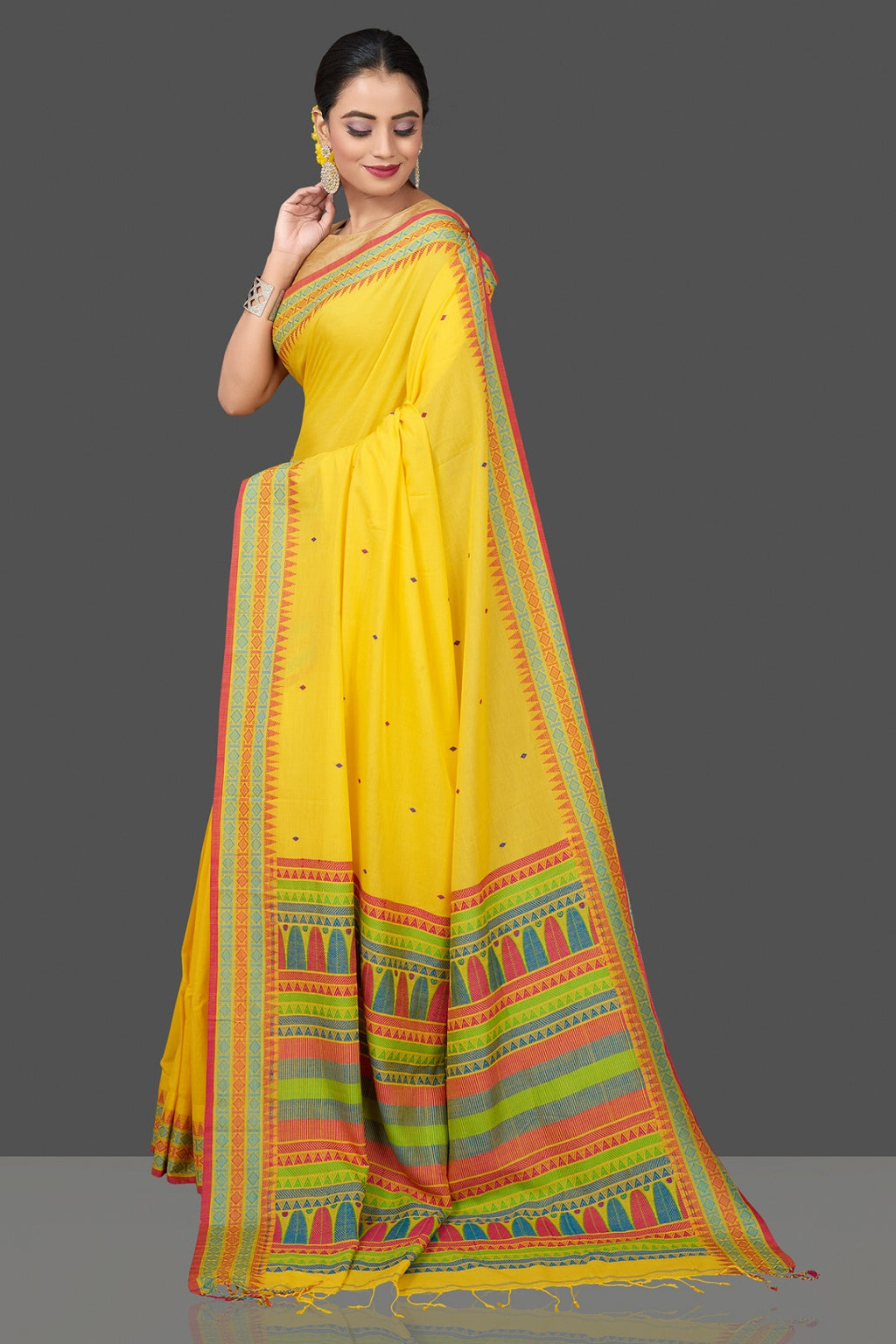 Buy stunning yellow cotton silk saree online in USA with weave border and pallu. Flaunt Indian fashion in USA with a stunning collection of handwoven sarees, cotton sarees, pure silk sarees, designer sarees in USA from Pure Elegance Indian saree store in USA.-full view